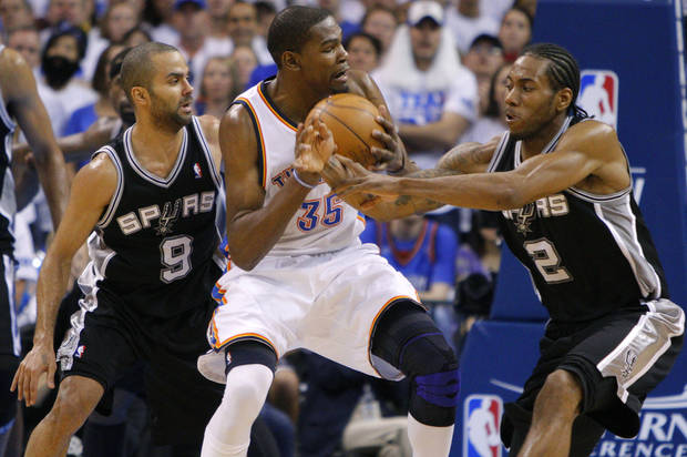 Oklahoma City's Kevin Durant (35) goes between San Antonio's Tony Parker (9) and Kawhi Leonard during Game 4 of the Western Conference Finals between the Oklahoma City Thunder and the San Antonio Spurs in the NBA playoffs at the Chesapeake Energy Arena in Oklahoma City, Saturday, June 2, 2012. Oklahoma CIty won 109-103. Photo by Bryan Terry, The Oklahoman