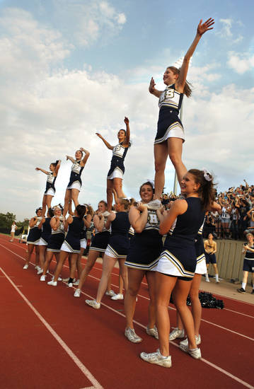 Southmoore Sabercat cheerleaders cheer as they play the Westmoore Jaguars in high school football on Friday, Sept. 7, 2012, in Moore, Okla.  Photo by Steve Sisney, The Oklahoman