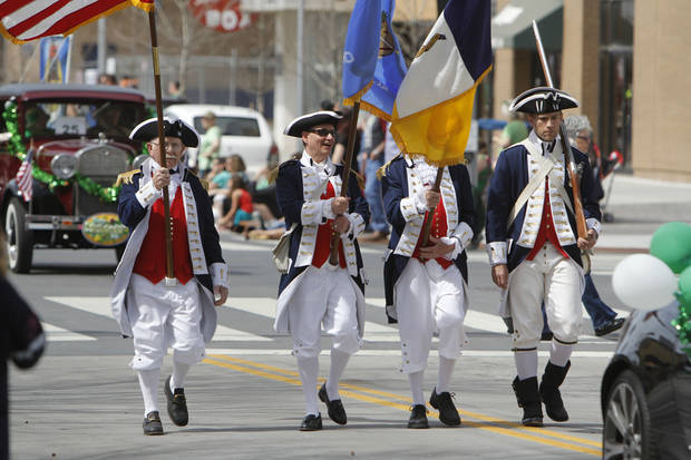 An honor guard in Revolutionary War costumes carry the colors in the annual Saint Patrick's Day Parade in downtown Oklahoma City, OK, Saturday, March 16, 2013,  By Paul Hellstern, The Oklahoman