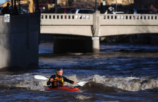 An unidentified kayaker takes advantage of the surging Truckee River, in downtown Reno, Nev., on Sunday, Dec. 2, 2012, as a heavy, wet storm hits the Northern Nevada region. The storm delivered more snow and less rain than forecast, blunting the flood danger. (AP Photo/Cathleen Allison)