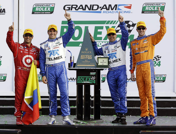 From left, Ganassi Racing team drivers Juan Pablo Montoya, of Colombia, Memo Rojas, of Mexico, Charlie Kimball and Scott Pruett celebrate after winning the Grand-Am Series Rolex 24 hour auto race at Daytona International Speedway, Sunday, Jan. 27, 2013, in Daytona Beach, Fla. (AP Photo/John Raoux)