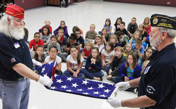 Disabled American Veterans Terry Farmer and Don Kasper fold the flag for students at Eastlake Elementary School during a flag retirement ceremony, Tuesday, November 8, 2011.     Photo by David McDaniel, The Oklahoman