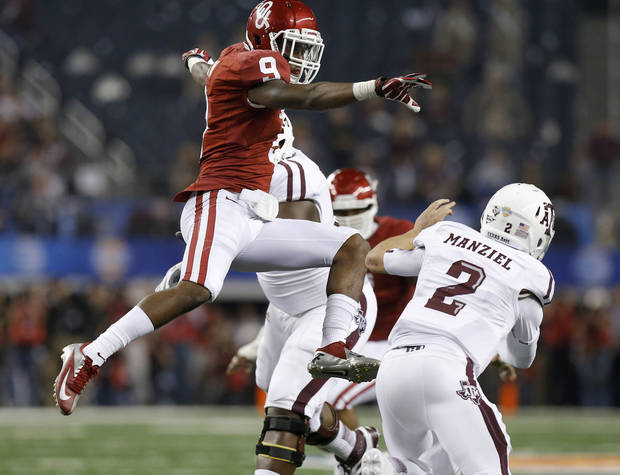 Oklahoma's Gabe Lynn (9) leaps at Texas A&M 's Johnny Manziel (2) during the Cotton Bowl college football game between the University of Oklahoma (OU)and Texas A&M University at Cowboys Stadium in Arlington, Texas, Friday, Jan. 4, 2013. Oklahoma lost 41-13. Photo by Bryan Terry, The Oklahoman