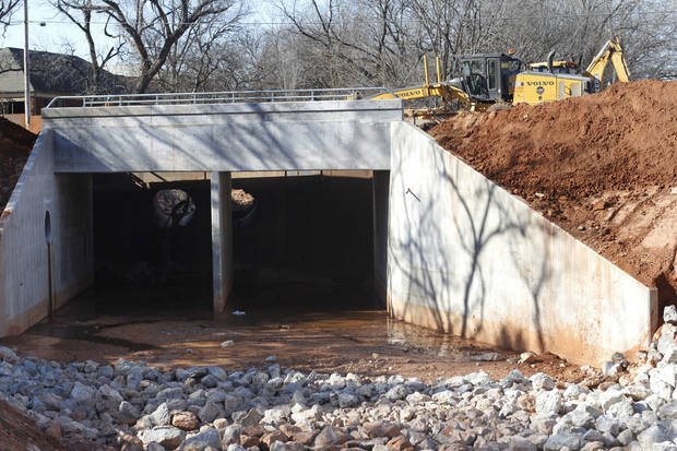 Work continues on the Bryant Avenue bridge replacement project in Edmond. Asphalt base work is expected to be completed this week on the east side of the roadway. One lane of traffic is open on Bryant Avenue just south of 15th Avenue. PHOTO BY PAUL HELLSTERN, THE OKLAHOMAN. <strong>PAUL HELLSTERN - THE OKLAHOMAN</strong>