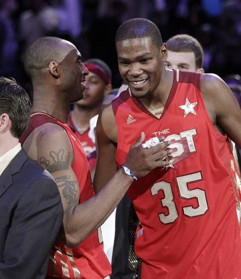 West's Kobe Bryant, left, of the Los Angeles Lakers, talks to Kevin Durant, of the Oklahoma City Thunder, as they celebrate the West's 148-143 win against the East in the NBA basketball All-Star Game in Los Angeles, Sunday, Feb. 20, 2011. (AP Photo/Jae C. Hong)