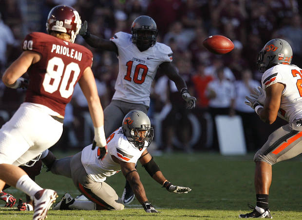Oklahoma State 's Brodrick Brown (19) watches his tipped pass intercepted by James Thomas (22) in the second half during a college football game between the Oklahoma State Cowboys (OSU) and the Texas A&M Aggies at Kyle Field in College Station, Texas, Saturday, Sept. 24, 2011. Photo by Sarah Phipps, The Oklahoman  ORG XMIT: KOD