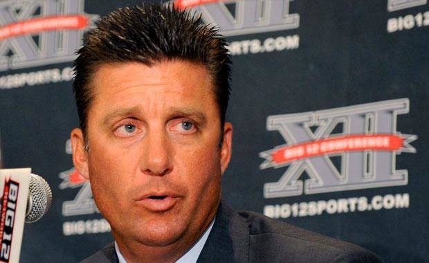 Oklahoma State coach Mike Gundy  answers reporters questions during a news conference at the Big 12 Football Media Day, Tuesday, July 27, 2010, in Irving, Texas. (AP Photo/Cody Duty)