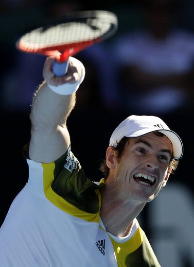 Britain's Andy Murray serves to Lithuania's Ricardas Berankis during their third round match at the Australian Open tennis championship in Melbourne, Australia, Saturday, Jan. 19, 2013. (AP Photo/Andy Wong)