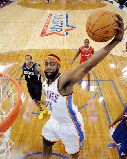 Oklahoma City Thunder's James Harden, of the sophomore team, goes up for a dunk as Minnesota Timberwolves' Wesley Johnson, left, and Los Angeles Clippers' Eric Bledsoe, of the rookie team, look on  during the Rookie Challenge game at the NBA basketball All-Star Weekend, Friday, Feb. 18, 2011, in Los Angeles. (AP Photo/Mark J. Terrill)
