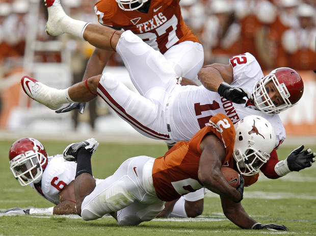 Oklahoma's Travis Lewis brings down Texas' Fozzy Whittaker (2) during the Red River Rivalry college football game between the University of Oklahoma Sooners (OU) and the University of Texas Longhorns (UT) at the Cotton Bowl in Dallas, Saturday, Oct. 8, 2011. Photo by Bryan Terry, The Oklahoman