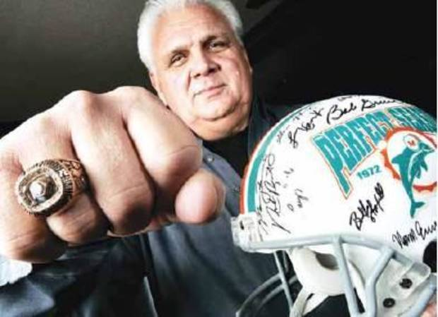 In this 2005 photo, former Miami Dolphins and University of Oklahoma football player Jim Riley is shown with his Super Bowl ring and an autographed helmet from a perfect season with the Miami Dolphins. PHOTO BY BRYAN TERRY, THE OKLAHOMAN ARCHIVES