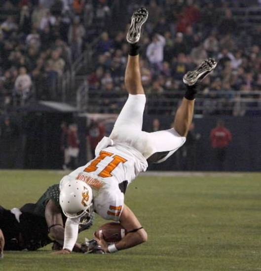 OSU's Zac Robinson is brought down during the Holiday Bowl college football between Oklahoma State and Oregon at Qualcomm Stadium in San Diego, Tuesday, Dec. 30, 2008. PHOTO BY BRYAN TERRY