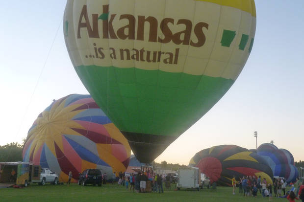 If weather permits, balloonists fly in the early morning and early evening during the state hot air balloon championships. At dusk on Saturday, pilots blow up their balloons and offer tethered rides, a popular event with Harrison residents. Photo by Timothy Burk <strong></strong>