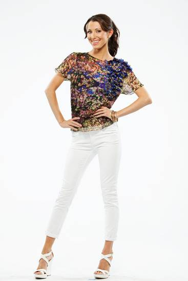 Ted Baker floral top, Habitual Aaron rolled jeans, Judith Leiber bracelets, Crislu earrings, all from Liberte. Photo provided. <strong></strong>