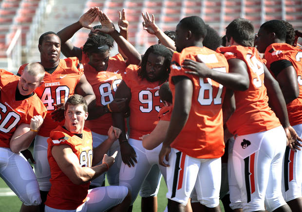 Oklahoma State football players pose for a photograph during Oklahoma State's football media day in Stillwater, Okla., Saturday, Aug. 4, 2012. Photo by Sarah Phipps, The Oklahoman