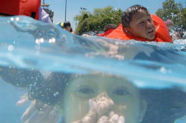 A few of the 1400 third and fourth grade Oklahoma City public school students swim during the Wacky Water Wahoo water safety class at White Water on Thursday, May 21, 2009, in Oklahoma City, Okla.   Photo by Chris Landsberger, The Oklahoman