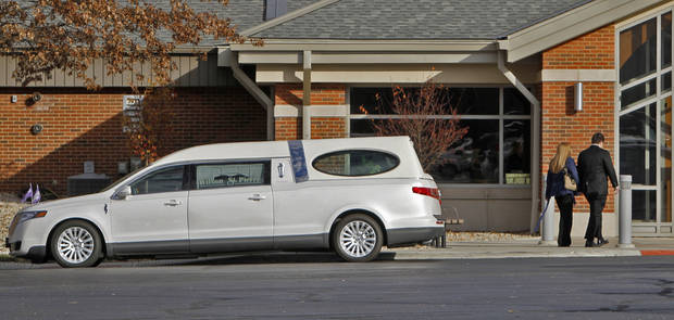 "People arrive at St. Barnabas Catholic Church, Monday, Nov. 19, 2012, for the funeral for Jennifer Longworth and her husband, John ""Dion"" Longworth in Greenwood, Ind. The couple were the only two people killed in the massive blast in the Richmond Hill subdivision. (AP Photo/The Indianapolis Star, Kelly Wilkinson"