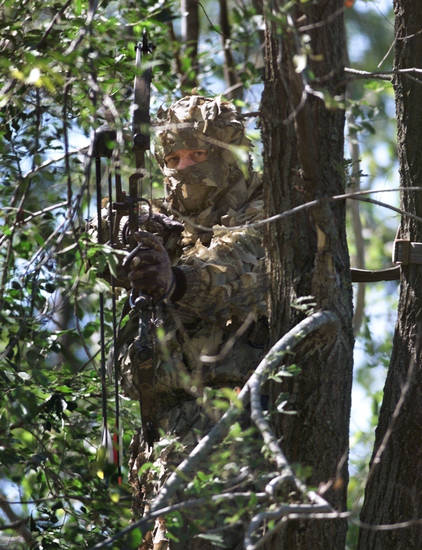 A bow hunter takes aim from a tree stand. Falling from a tree stand is the most common injury among deer hunters. Oklahoma�s deer gun season opens Saturday. Archery deer season remains open through Jan. 15. Photo from Oklahoman Archives