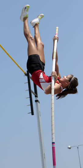 "Katie Whitekiller, Purcell junior, clears 12' 3"" for the win and a new state record height at the 3A and 4A state championship track meet on Saturday, May 5, 2012, in Ardmore, Okla.  Photo by Steve Sisney, The Oklahoman"