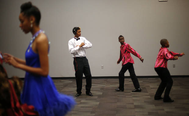James Cotton, 17, of John Marshall High School, passes time backstage at a dance competition at the Rose State Performing Arts Theatre in Midwest City. Photo by Bryan Terry, The Oklahoman <strong>BRYAN TERRY - THE OKLAHOMAN</strong>
