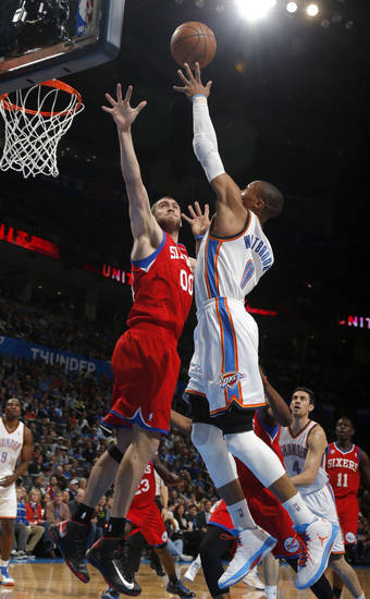 Oklahoma City's Russell Westbrook shoots a lay up as Philadelphia's Spencer Hawes (00) defends during the NBA game between the Oklahoma City Thunder and the Philadelphia 76ers at the Chesapeake Energy Arena in Oklahoma City, Friday,Jan. 4, 2013. Photo by Sarah Phipps, The Oklahoman