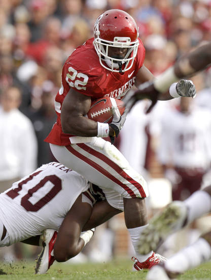 Oklahoma's Roy Finch (22) tries do get past Texas A&M's Sean Porter (10) during the college football game between the Texas A&M Aggies and the University of Oklahoma Sooners (OU) at Gaylord Family-Oklahoma Memorial Stadium on Saturday, Nov. 5, 2011, in Norman, Okla. Photo by Bryan Terry, The Oklahoman