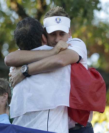 Europe's Francesco Molinari, left, and Ian Poulter celebrate after winning the Ryder Cup PGA golf tournament Sunday, Sept. 30, 2012, at the Medinah Country Club in Medinah, Ill. (AP Photo/Charlie Riedel)  ORG XMIT: PGA240
