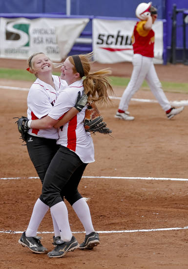 HIGH SCHOOL SOFTBALL TOURNAMENT / CELEBRATION: Wayne's Michal Hylton, left, and Chloe Clifton (4) celebrate the win during the Oklahoma State Softball tournament game between Wayne and Dale at ASA Hall of Fame Stadium on Thursday, Oct. 4, 2012, in Oklahoma City, Okla.   Photo by Chris Landsberger, The Oklahoman