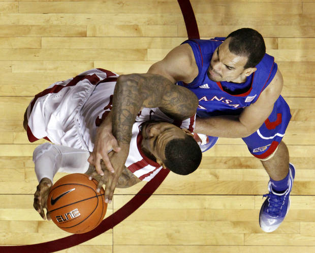 Oklahoma's Romero Osby (24) is fouled on a shot by Kansas' Perry Ellis (34) during the second half as the University of Oklahoma Sooners (OU) defeat the Kansas Jayhawks (KU) 72-66 in NCAA, men's college basketball at The Lloyd Noble Center on Saturday, Feb. 9, 2013 in Norman, Okla. Photo by Steve Sisney, The Oklahoman