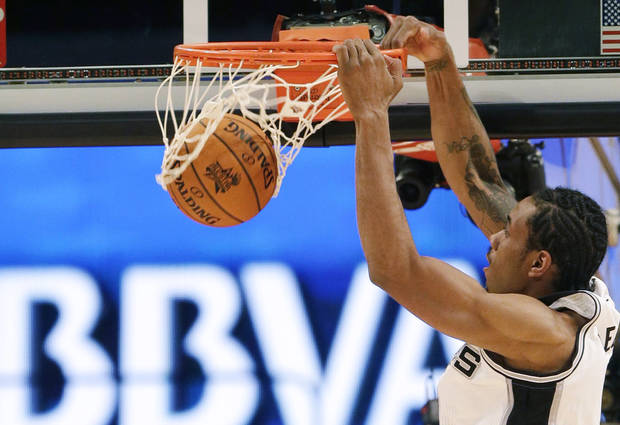 Team Chuck's Kawhi Leonard of the San Antonio Spurs dunks against Team Shaq during the first half of the Rising Stars Challenge basketball game at NBA All-Star Weekend Friday, Feb. 15, 2013, in Houston. (AP Photo/Eric Gay)
