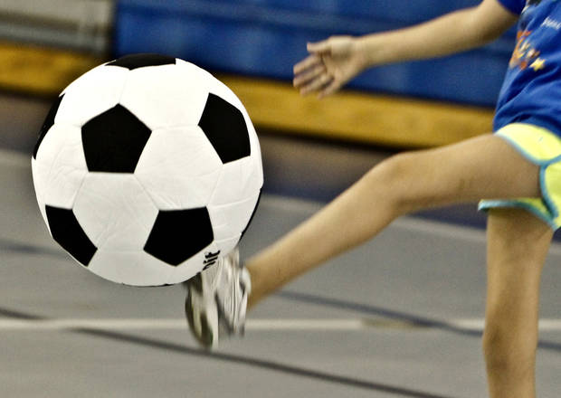 A soccer player kicks a ball during a Yukon Spirit League soccer practice. The Oklahoman Archives