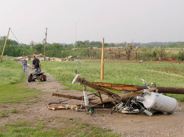 What little remains of a double-wide trailer home (foreground) and a two-story home owned by Steve and Kelly Johnson in Cole, Oklahoma Tuesday, May 24, 2011. Photo by David Zizzo, The Oklahoman