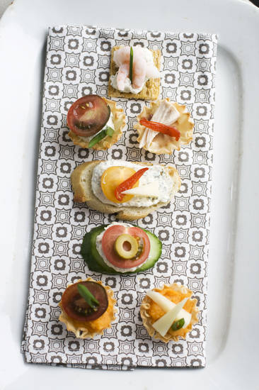 In this Jan. 28, 2013 photo, using our building block approach to Oscar party canapes, diners are able to select from a buffet of ingredients -- from bases and spreads to toppings and garnishes -- to design snacks that suit their preferences as shown on this serving tray in Concord, N.H. (AP Photo/Matthew Mead) ORG XMIT: NYLS865