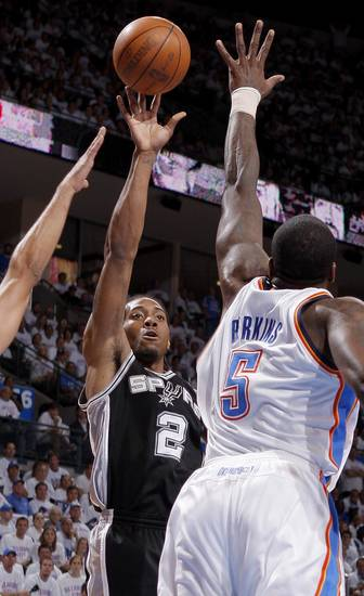 San Antonio's Kawhi Leonard (2) shoots the ball over Oklahoma City's Kendrick Perkins (5) during Game 6 of the Western Conference Finals between the Oklahoma City Thunder and the San Antonio Spurs in the NBA playoffs at the Chesapeake Energy Arena in Oklahoma City, Wednesday, June 6, 2012. Photo by Bryan Terry, The Oklahoman