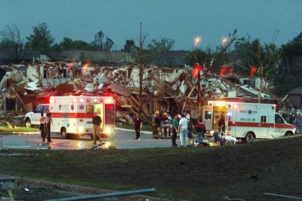 May 3, 1999 Oklahoma City Tornado:  Rescue workers load victims into ambulances across from Westmoore High School on S Western.  Staff Photo by Steve Sisney