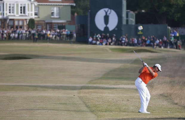 Lee Westwood of England plays a shot on the 18th hole during the third round of the British Open Golf Championship at Muirfield, Scotland, Saturday July 20, 2013. (AP Photo/Peter Morrison)