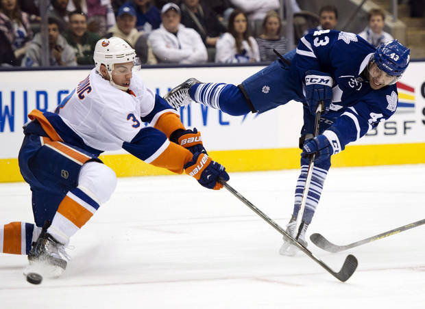 Toronto Maple Leafs center Nazem Kadri (43) shoots past New York Islanders defenseman Travis Hamoic (3) during the second period of an NHL hockey game, Thursday, Jan. 24, 2013, in Toronto. (AP Photo/The Canadian Press, Frank Gunn)