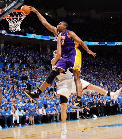 GAME THREE / L.A. LAKERS: Oklahoma City's Nick Collison (4) fouls L.A.'s Andrew Bynum (17) in the fourth quarter during the NBA basketball game between the Los Angeles Lakers and the Oklahoma City Thunder in the first round of the NBA playoffs at the Ford Center in Oklahoma City, Thursday, April 22, 2010. Oklahoma City won, 101-96. Photo by Nate Billings, The Oklahoman ORG XMIT: KOD