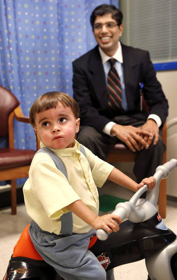 Troy Yoder, 3, is pictured Monday with Dr. Vivek Kohli, associate director, hepatobiliary and transplant surgery at Integris Baptist Medical Center.  Photo by Jim Beckel, The Oklahoman