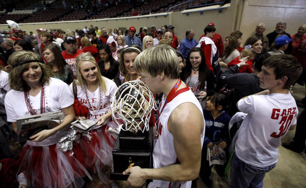 Forgan's Tanner Jones kisses the Class B championship trophy after beating Arnett in the championship game of the boys Class B state basketball tournament at the State Fair Arena in Oklahoma City,  Saturday, March 3, 2012. Photo by Sarah Phipps, The Oklahoman
