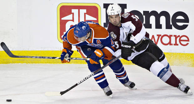 Colorado Avalanche's Shane O'Brien and Edmonton Oilers' Jordan Eberle battle for the puck during the first period of their NHL hockey game, Monday, Jan. 28, 2013, in Edmonton, Alberta. (AP Photo/The Canadian Press, Jason Franson)