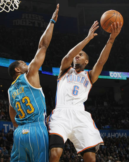 Oklahoma City's Eric Maynor (6) shoots over Willie Green (33) of New Orleans during the NBA basketball game between the New Orleans Hornets and the Oklahoma City Thunder at the Oklahoma City Arena in downtown Oklahoma City, Monday, Nov. 29, 2010. Photo by Nate Billings, The Oklahoman