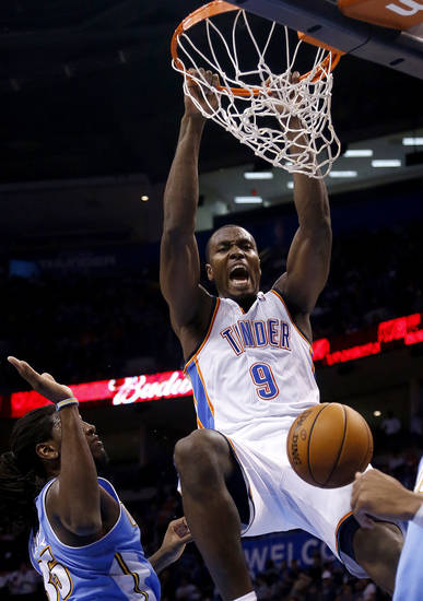 Oklahoma City&#039;s Serge Ibaka (9) dunks over Denver&#039;s Kenneth Faried (35) during the NBA preseason basketball game between the Oklahoma City Thunder and the Denver Nuggets at the Chesapeake Energy Arena, Sunday, Oct. 21, 2012. Photo by Sarah Phipps, The Oklahoman