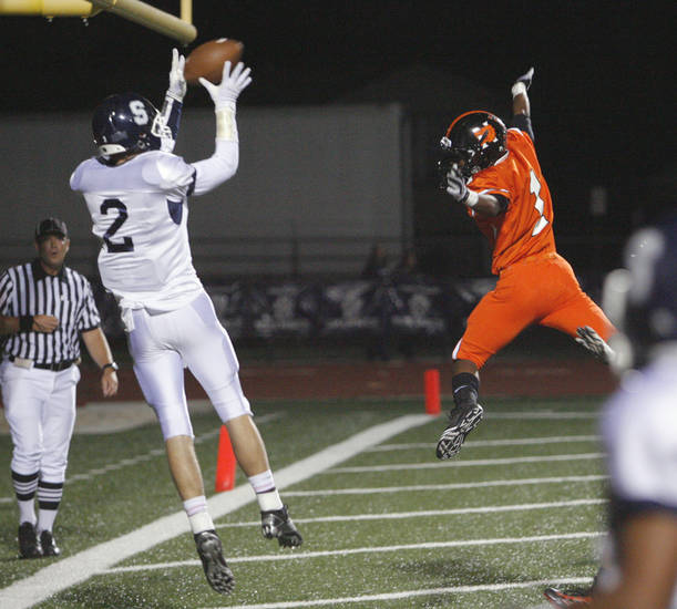 Shawnee's Brayle Brown (2) catches a pass in front of Norman High School's Brad Davis in the end zone, but comes down out of bounds for no score in high school football at Harve Collins field on Thursday, Sept. 30, 2010, in Norman, Okla.  Photo by Steve Sisney, The Oklahoman