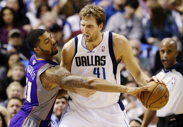 Dallas Mavericks' Dirk Nowitzki (41), of Germany, fights Phoenix Suns' Markieff Morris (11) for an opening to the basket in the first half of an NBA basketball game, Sunday, Jan. 27, 2013, in Dallas. (AP Photo/Tony Gutierrez)