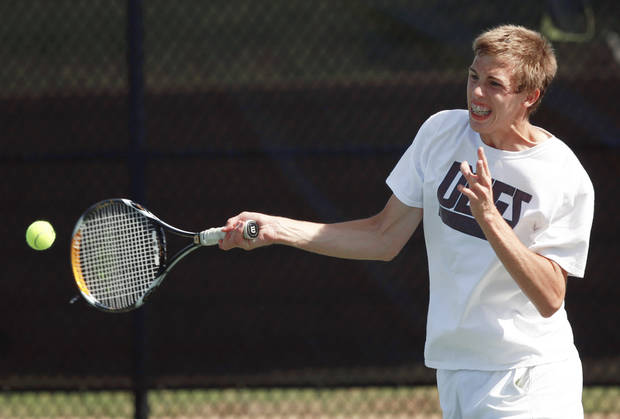 Edmond Memorial's Duncan Fugitt returns a serve to PC North's Chris Haworth at the Oklahoma City Tennis Center on Saturday.  Photo by  Sarah Phipps,  The Oklahoman