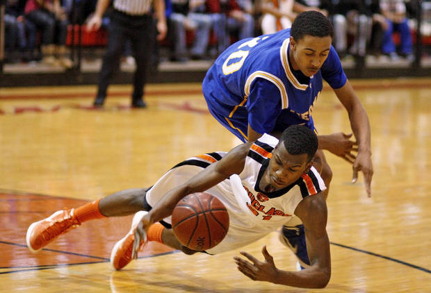 Dydrell Post of Douglass goes for the ball under Piedmont's Adrion Williams during a Class 4A boys basketball state tournament game in Midwest CIty, Okla., Thursday, March 8, 2012. Photo by Bryan Terry, The Oklahoman