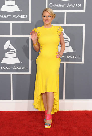 Carrie Keagan arrives at the 55th annual Grammy Awards on Sunday, Feb. 10, 2013, in Los Angeles.  (Photo by Jordan Strauss/Invision/AP) ORG XMIT: CADC107
