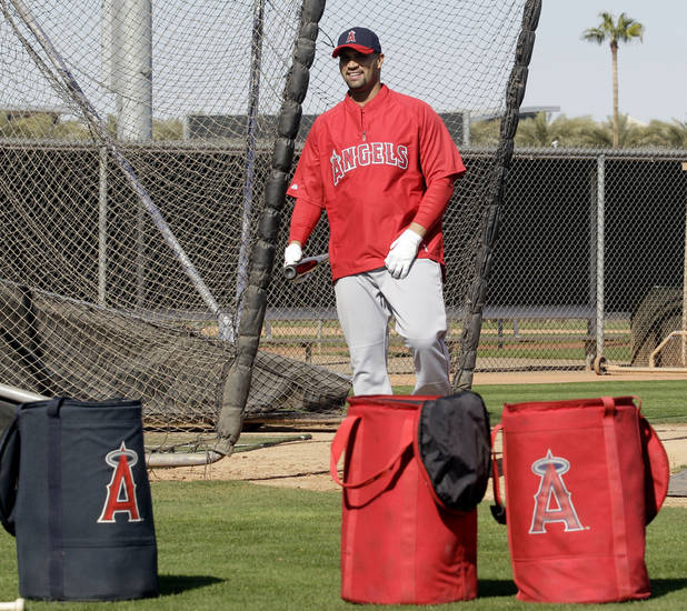 Los Angeles Angels' Albert Pujols walks out of the batting cage during a baseball spring training workout Monday, Feb. 20, 2012, in Tempe, Ariz. (AP Photo/Morry Gash)
