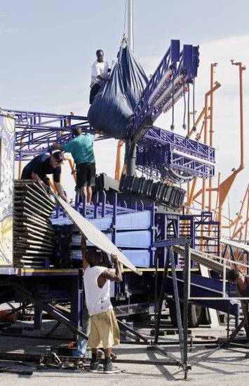"Workers set up a ride on the midway called ""Music Fest"" for the Oklahoma State Fair that begins today at State Fair Park in Oklahoma City.  <strong>PAUL B. SOUTHERLAND - PAUL B. SOUTHERLAND</strong>"